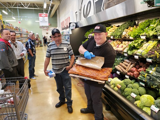 Lucky's Market kicked off their new store opening in North Naples with a bacon cutting ceremony on Wednesday, April 17, 2019. This is the huge slab of pork belly that was cut.
