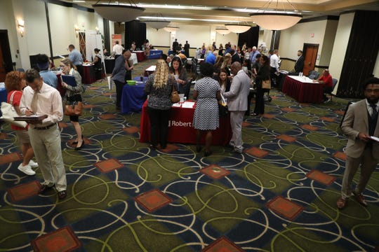 Dozens of businesss were looking to hire employees at a job fair at the Crowne Plaza hotel at the Bell Tower Shops in Fort Myers on Wednesday April 17, 2019.