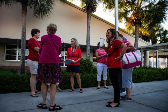 Osceola Elementary School teachers wait together before the walk-in in North Naples on Wednesday, April 17, 2019. Many Collier County teachers joined educators across Florida in a 'walk-in' to support increased funding for public schools.