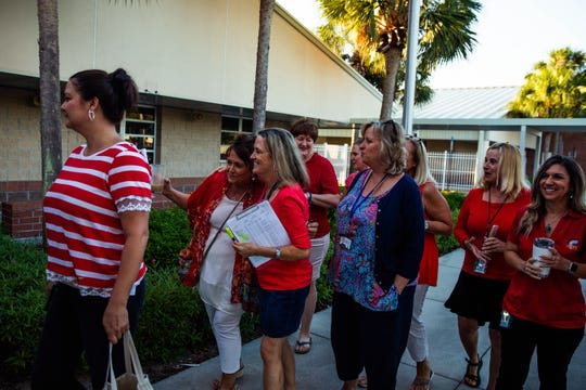 Union representative Lera Brial hugs teacher Sue Castleberry as they walk in together at Osceola Elementary School in North Naples on Wednesday, April 17, 2019. Their 'walk-in' was part of a statewide effort to support increased funding for public schools.
