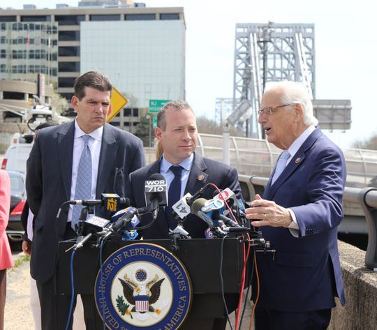 Fort Lee Mayor Mark Sokolich, left, and Reps. Josh Gottheimer and Bill Pascrell Jr. outlined the negative impacts of New York's plans to impose a congestion fee on vehicles entering midtown Manhattan. This is on the Lemoine Avenue overpass by the George Washington Bridge in Fort Lee on April 17, 2019.