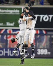 Apr 16, 2019; Bronx, NY, USA; New York Yankees right fielder Aaron Judge (99) and left fielder Mike Tauchman (39) celebrate after defeating the Boston Red Sox at Yankee Stadium.