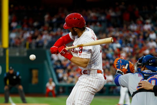 Philadelphia Phillies' Bryce Harper is hit by a pitch from New York Mets' Steven Matz during the first inning of a baseball game, Tuesday, April 16, 2019, in Philadelphia.