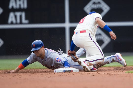 New York Mets right fielder Michael Conforto (30) steals second base against Philadelphia Phillies second baseman Cesar Hernandez (16) during the second inning at Citizens Bank Park.