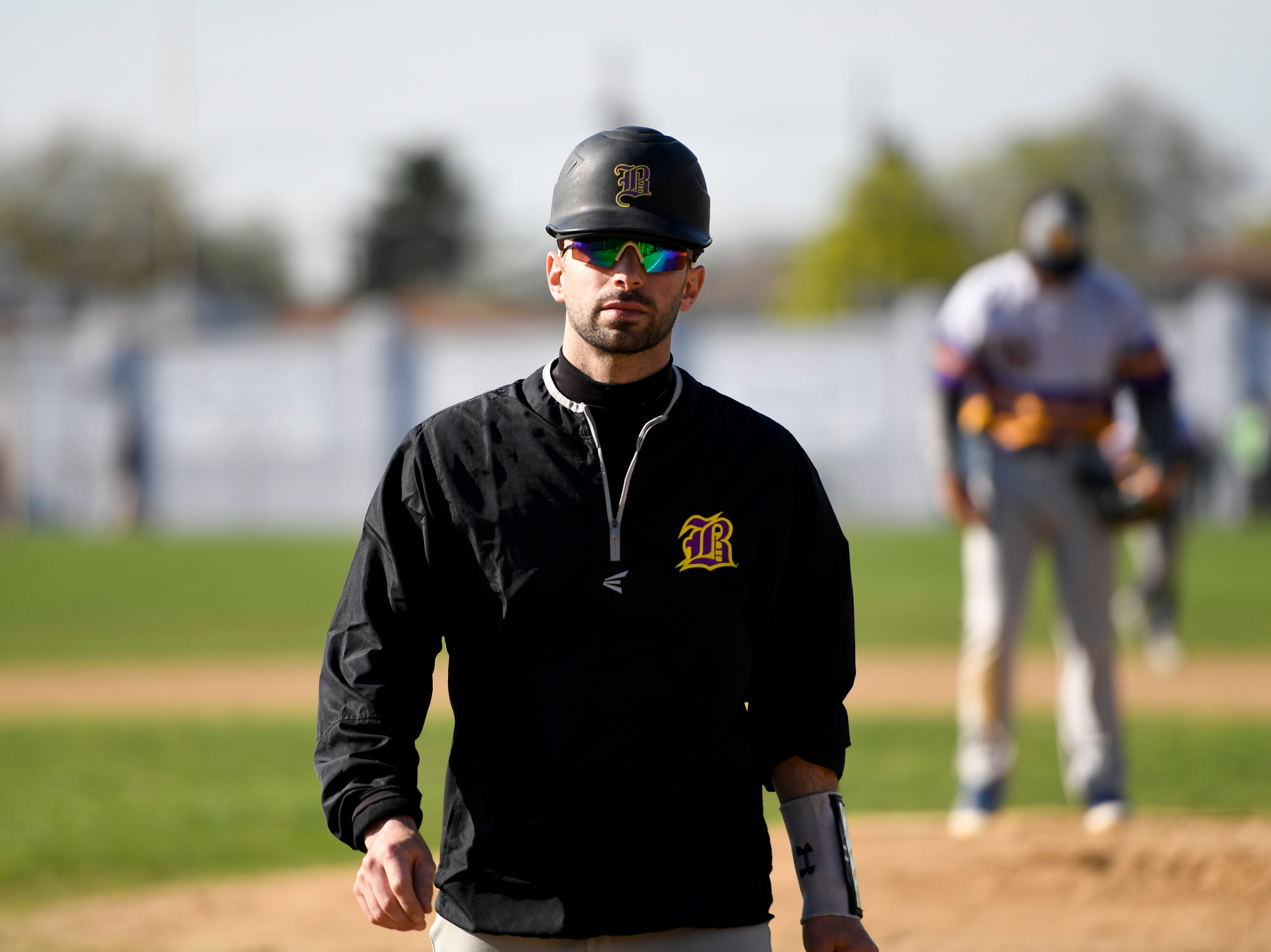 Bogota head coach Ryan Defeo walks from the pitchers mound as his team faces Garfield on Wednesday, April 17, 2019, in Garfield.