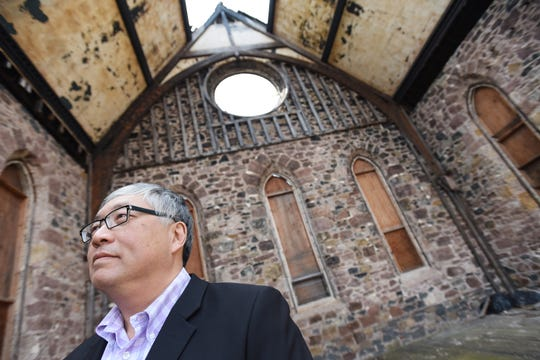 Pastor Richard Hong gives a tour of the area that burned in 2016 and talks about what the restoration work will look like, at First Presbyterian Church in Englewood on 04/17/19.