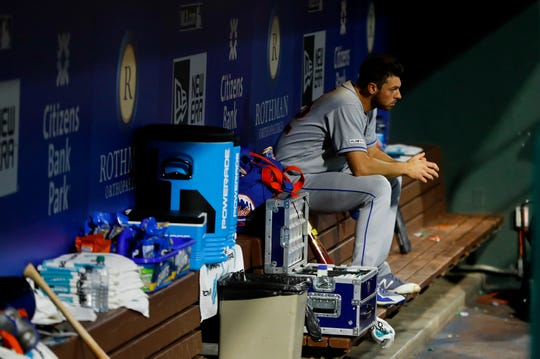 New York Mets starting pitcher Steven Matz sits in the dugout after being pulled during the first inning of a baseball game against the Philadelphia Phillies, Tuesday, April 16, 2019, in Philadelphia.
