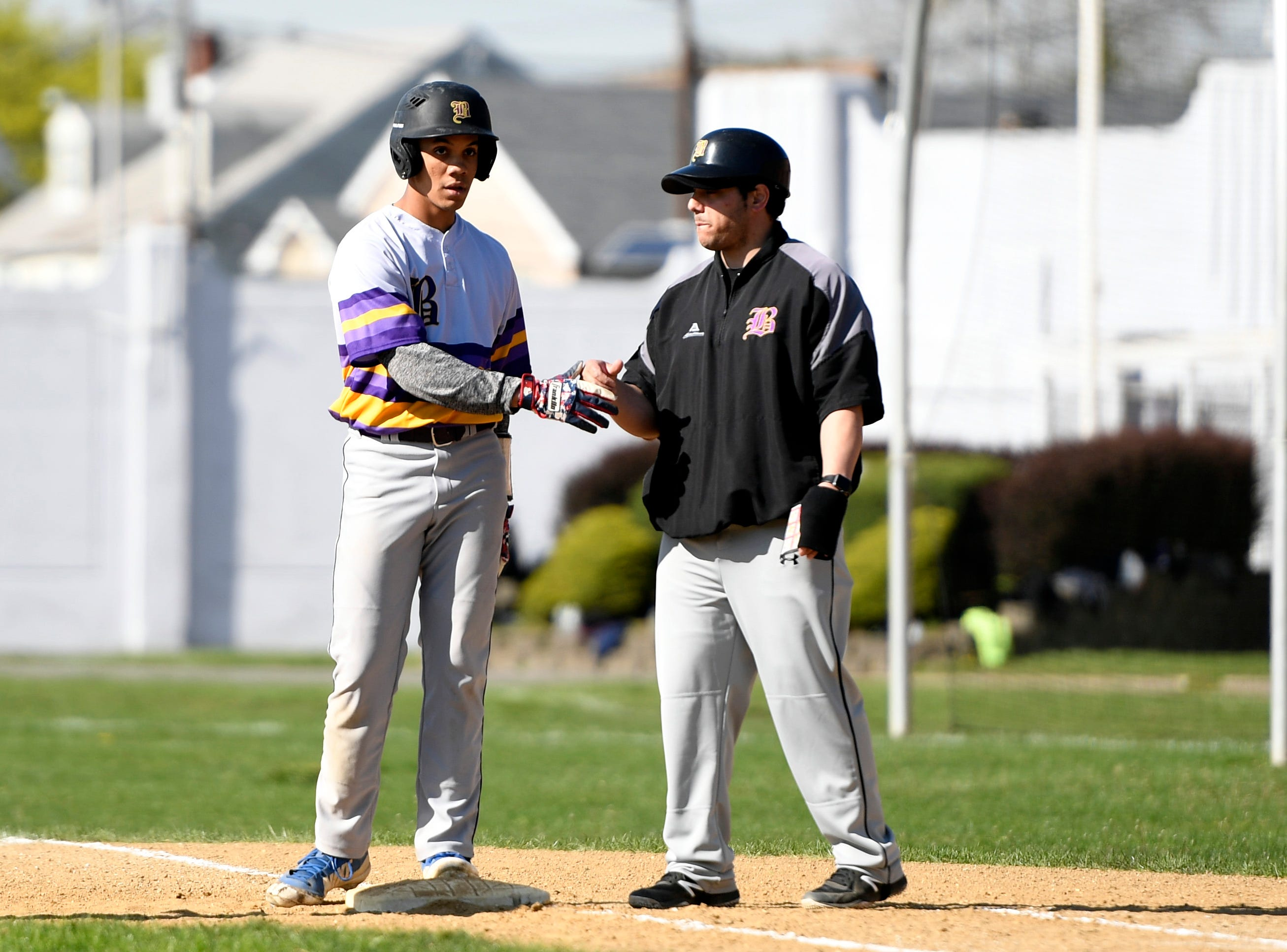 Bogota's Jose Marte, left, hits a single against Garfield on Wednesday, April 17, 2019, in Garfield.