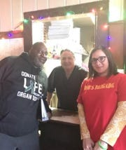NJ Sharing Network volunteer Jen Ehrentraut (in red shirt) with Patsy's co-owner, Steve Barbarulo (center) and Vernell Williams of Paterson, who had a heart transplant in 2015.