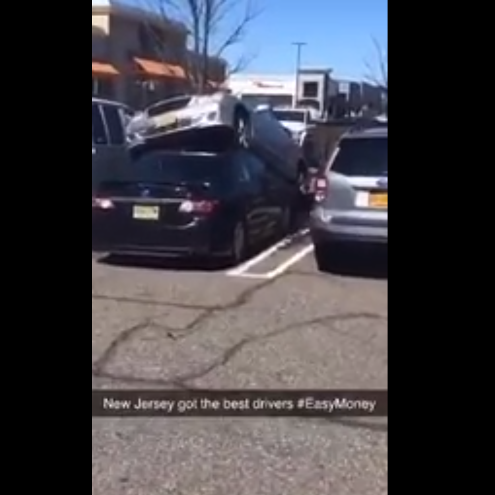 Car drives on top of another car at Bergen Town Center