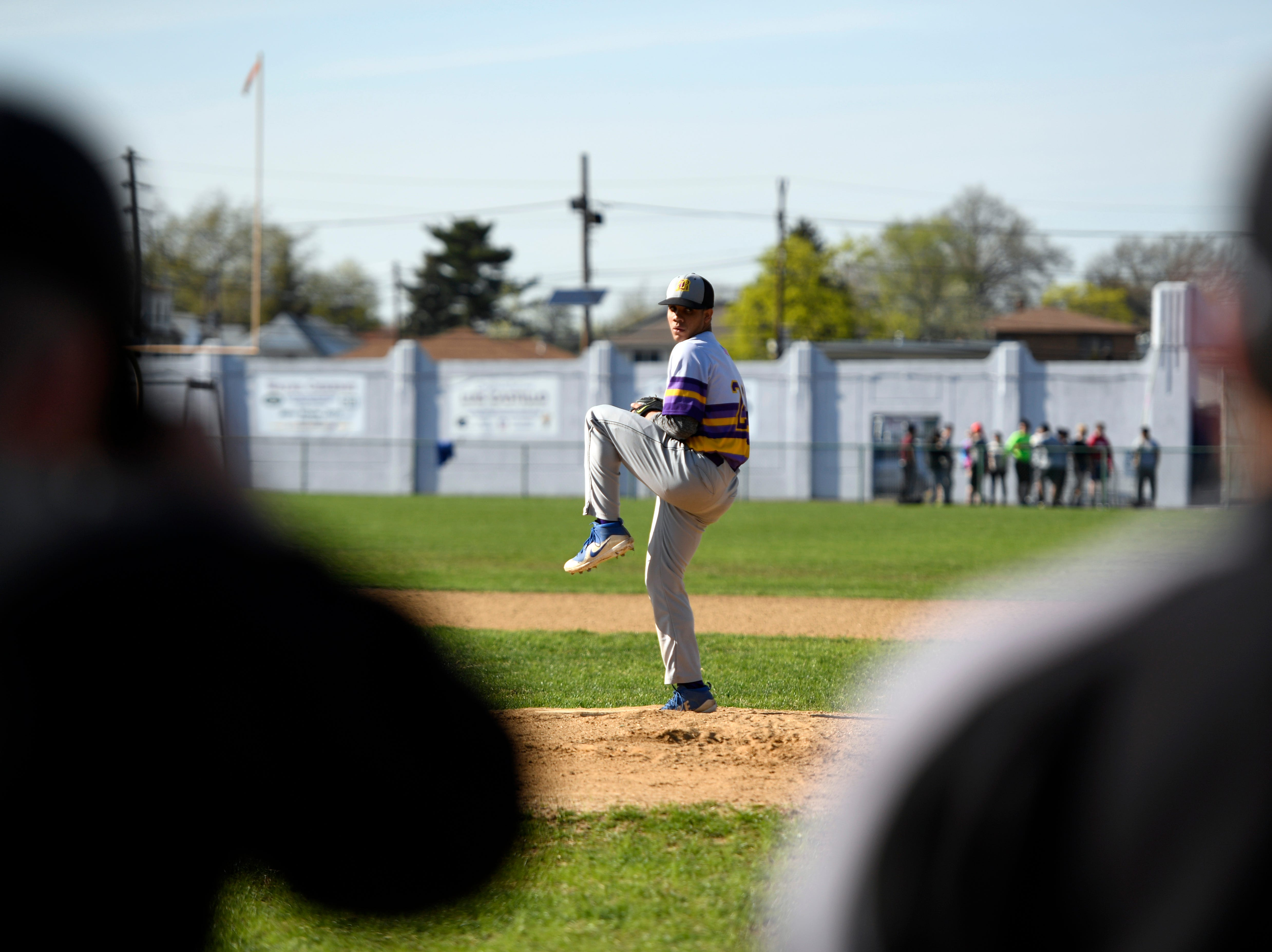 Bogota's Jose Marte pitches to Garfield as coaches look on, on Wednesday, April 17, 2019, in Garfield.