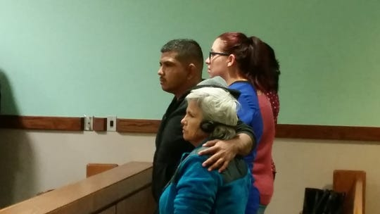 Chaparral resident Lorenzo Hernandez, left, who suffered a vicious machete attack in 2017 northwest of Las Cruces, stands with his mother, foreground, and girlfriend after a verdict of not guilty was announced in the case of a man who was accused of attacking him.