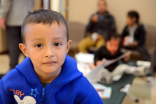 A young migrant at the Doña Ana Crisis Triage Center, which has been converted into a temporary shelter for asylum seekers, on Wednesday, April 17, 2019.