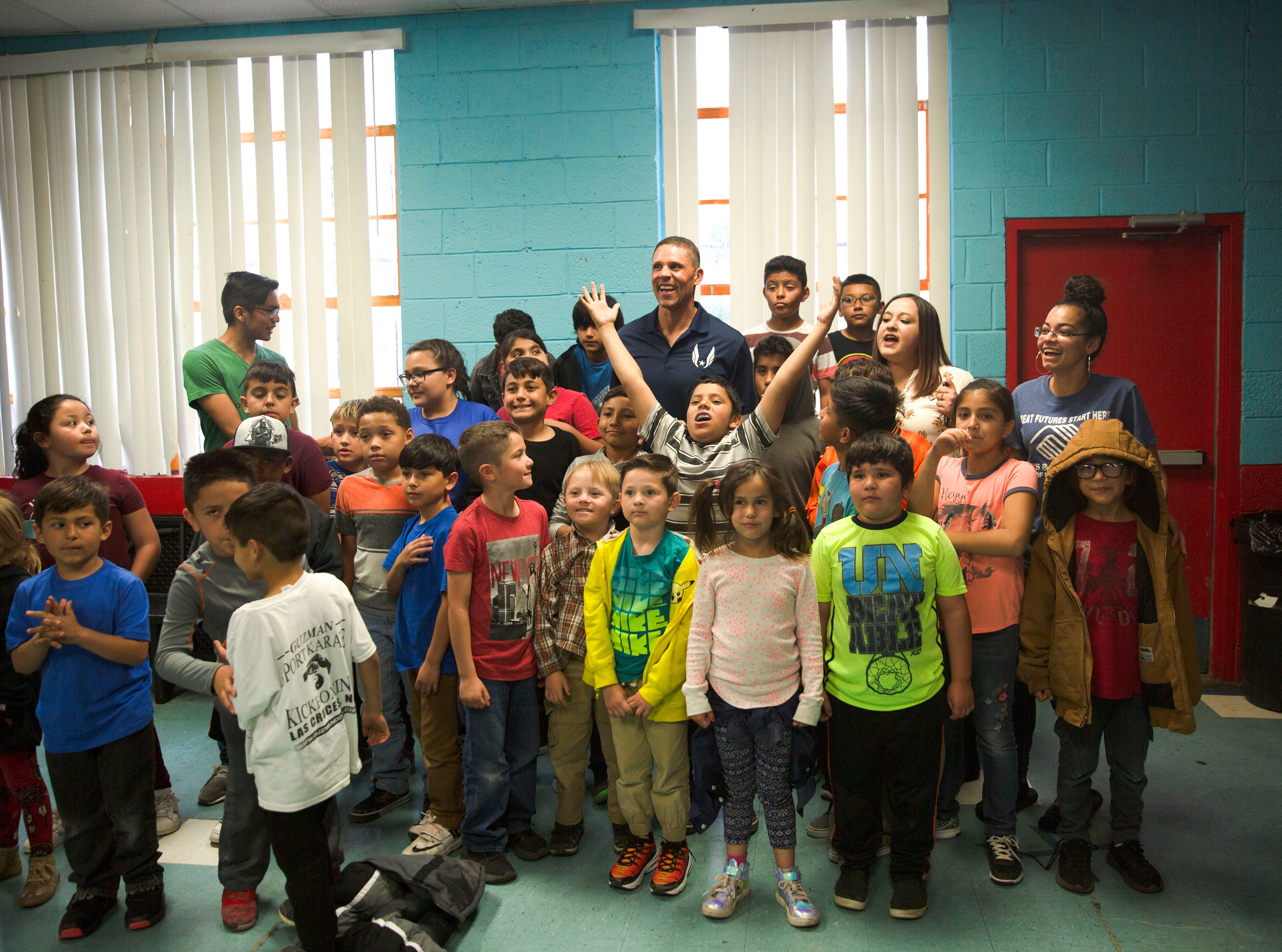 Olympic gold medalist Dan O'Brien poses with children at the Las Cruces Boys and Girl's Club, Wednesday April 17, 2019. O'Brien is the keynote speaker at the Lou and Mary Henson Community Breakfast.