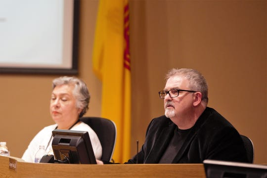 Las Cruces Public Schools Superintendent Greg Ewing, right, listens as attorney CaraLyn Banks (not pictured) criticizes his administration during public comments at the Board of Education meeting on Tuesday, April 16, 2019.