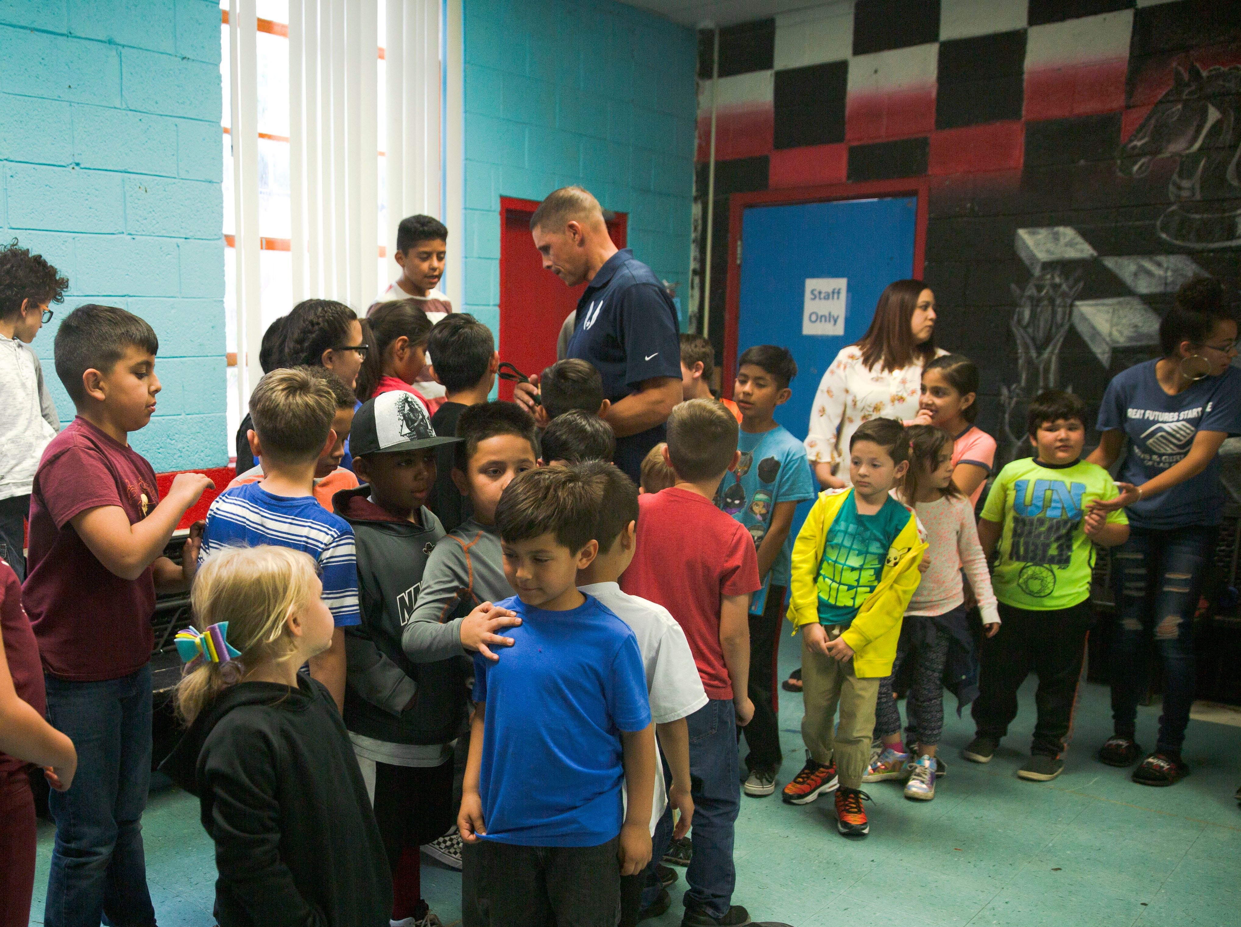 Olympic gold medalist Dan O'Brien greets children at the Las Cruces Boys and Girl's Club, Wednesday April 17, 2019, after speaking to them about always putting forth a good effort.