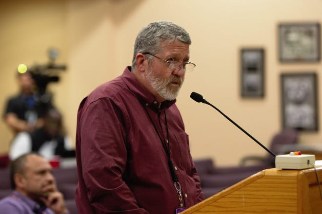 Las Cruces Public Schools Chief Financial Officer Ed Ellison delivers a budget report to the Board of Education at their April 16, 2019 meeting.