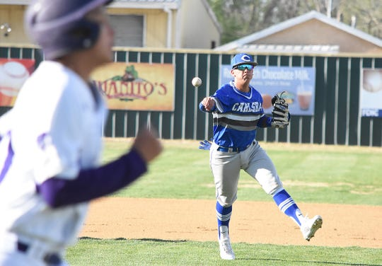 Carlsbad third baseman TJ Ruiz makes the putout throw to first in the second inning of Tuesday's District 4-5A opener at Bell Park in Clovis.