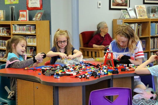 Left to right: Kinsley Jones, 6, Cassie Keller, 5, and Serenity Keller, 11, work on creating LEGO structures as part of the Carlsbad Public Library's LEGO Club. The Club meets every Wednesday during the school year at 1 p.m. at the Carlsbad Public Library.
