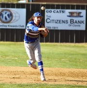 Carlsbad shortstop Josh Echavarria makes a throw to first for an out.