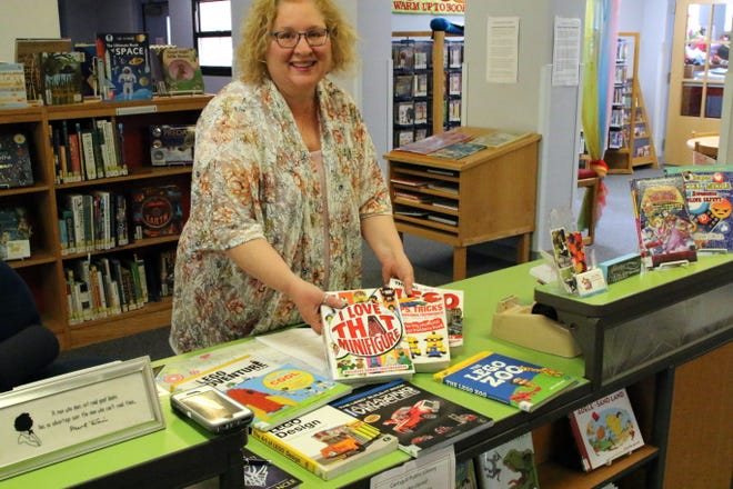 Beth Nieman shows the display of the non-fiction books on LEGOs which show how to create structures and give ideas for other LEGO creations.