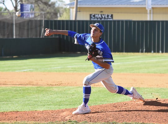 Cavemen starting pitcher Will Garza fires a pitch in Tuesday's District 4-5A opener at Bell Park in Clovis.