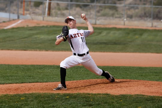 Aztec's Garrett Parker fires a pitch against Kirtland Central during Tuesday's District 1-4A game at AHS.