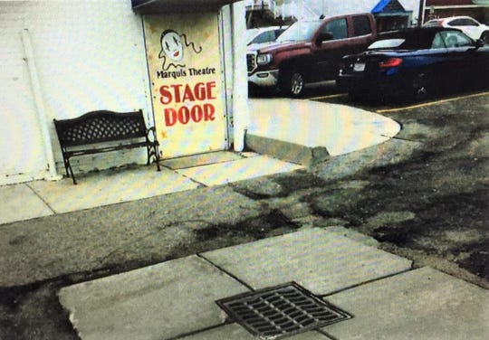 A poorly-positioned curb (just to the right of the Marquis Theatre rear entrance) is at the forefront of a lawsuit that claims a woman suffered serious injuries after tripping over the object.