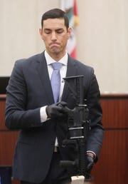 Deputy District Attorney Manny Bustamante held up AR-15 so jurors could see it during the trial of John Hernandez Felix, who faces the death penalty in the 2016 shooting deaths of Palm Springs police officers Jose Gilbert Vega and Lesley Zerebny (April 17, 2019)