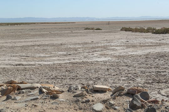 The shrinking Salton Sea can be seen in the distance beyond an area of exposed playa where the shoreline used to abut the Elmore Farm near Brawley, April 11, 2019.