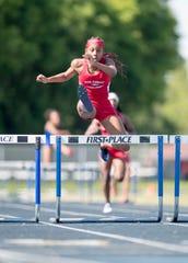 Pine Forest's Koriyunna Arrington leaps over the final hurdle on her way to first place in the Girls 300 Meter Hurdles during the 1-3A track and field championships at Booker T. Washington High School in Pensacola on Tuesday, April 16, 2019.