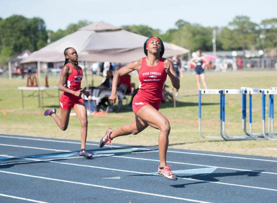 Pine Forest's Autaliah Williams-Gould crosses the finish line for a first place win in the Girls 200 Meter Dash during the 1-3A track and field championships at Booker T. Washington High School in Pensacola on Tuesday, April 16, 2019.