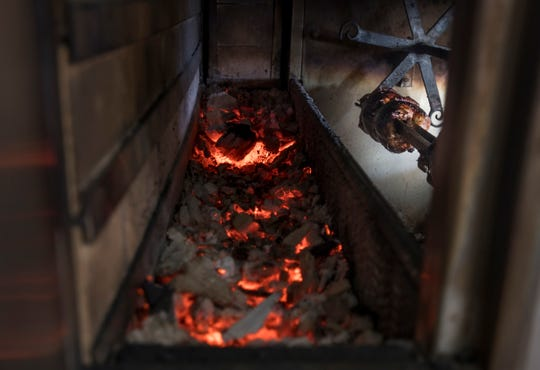 Chicken cooks in the charcoal rotisserie at the new Mr. Pollo Pensacola restaurant on Ninth Avenue in Pensacola on Wednesday.