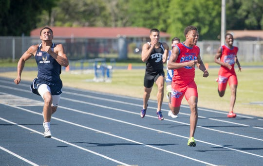 Pine Forest's Ladarius Clardy finishes ahead  of  Gulf Breeze's Christian Murphy and Tate's Gavin Grice to win the Boys 200 m Dash during the 1-3A track and field championships at Booker T. Washington High School in Pensacola on Tuesday, April 16, 2019.