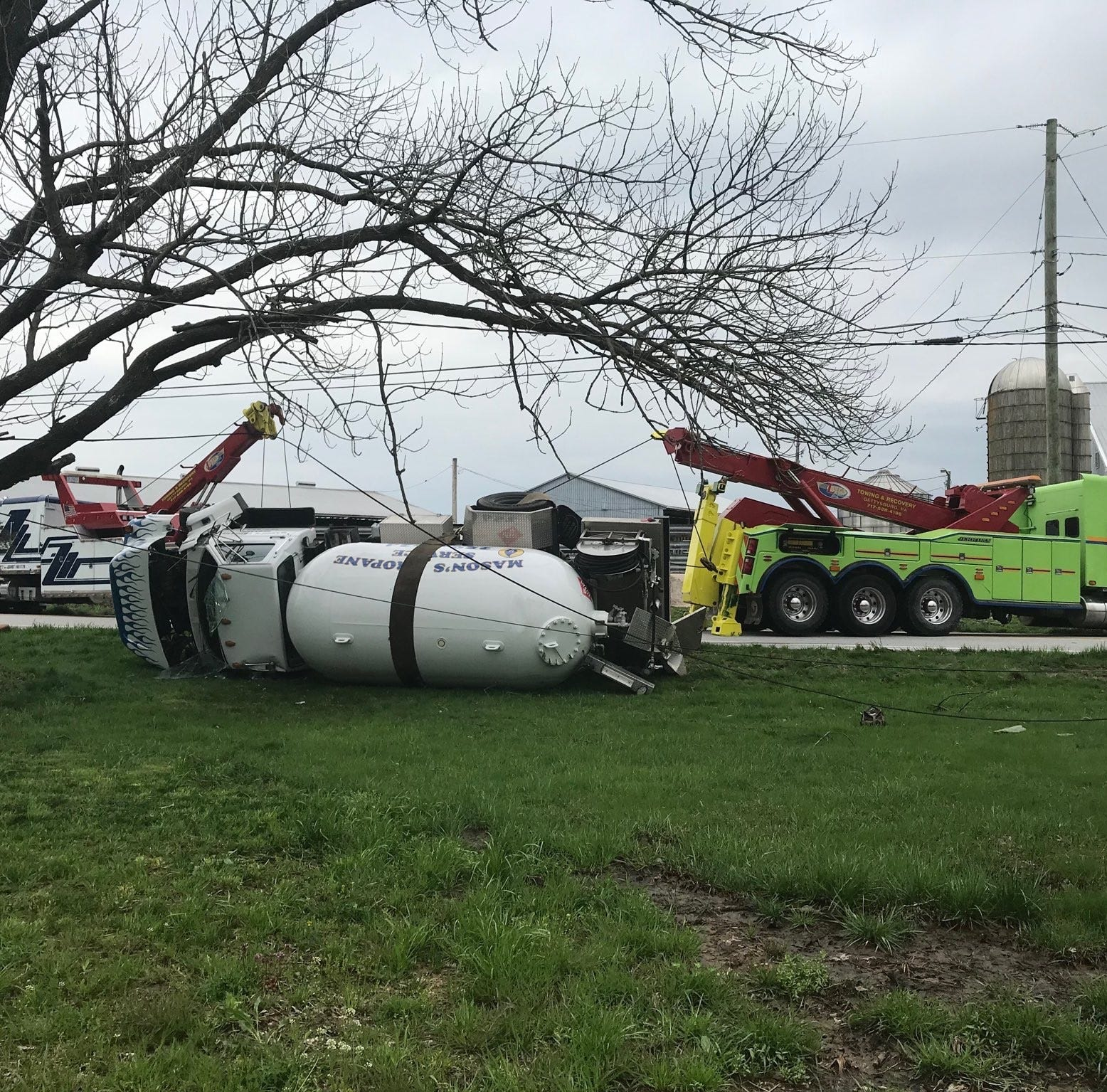 Propane truck overturns into front yard off Reading Township road