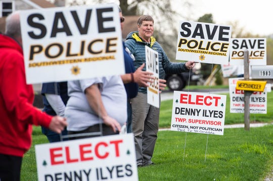 Bill Kaiser shows his support for Southwestern Regional Police and Denny Ilyes during a demonstration near the North Codorus Township building on Tuesday, April 16, 2019. The township continues to consider a plan to switch police providers at the end of 2019.