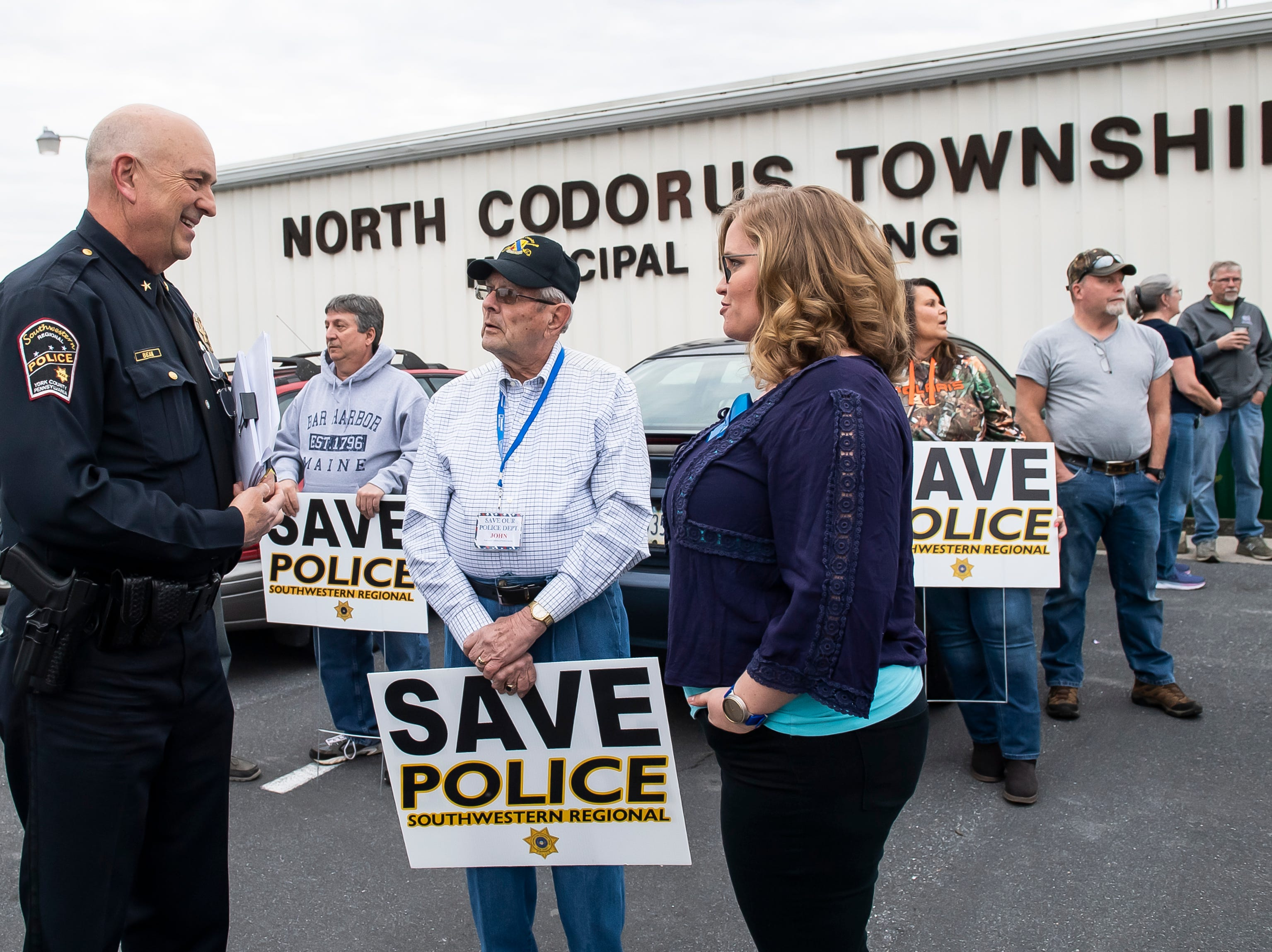 Southwestern Regional Police Chief Gregory Bean talks with John Rebert and Emily Levault before the start of a North Codorus Township meeting on Tuesday, April 16, 2019. The township continues to consider a plan to switch police providers at the end of 2019.