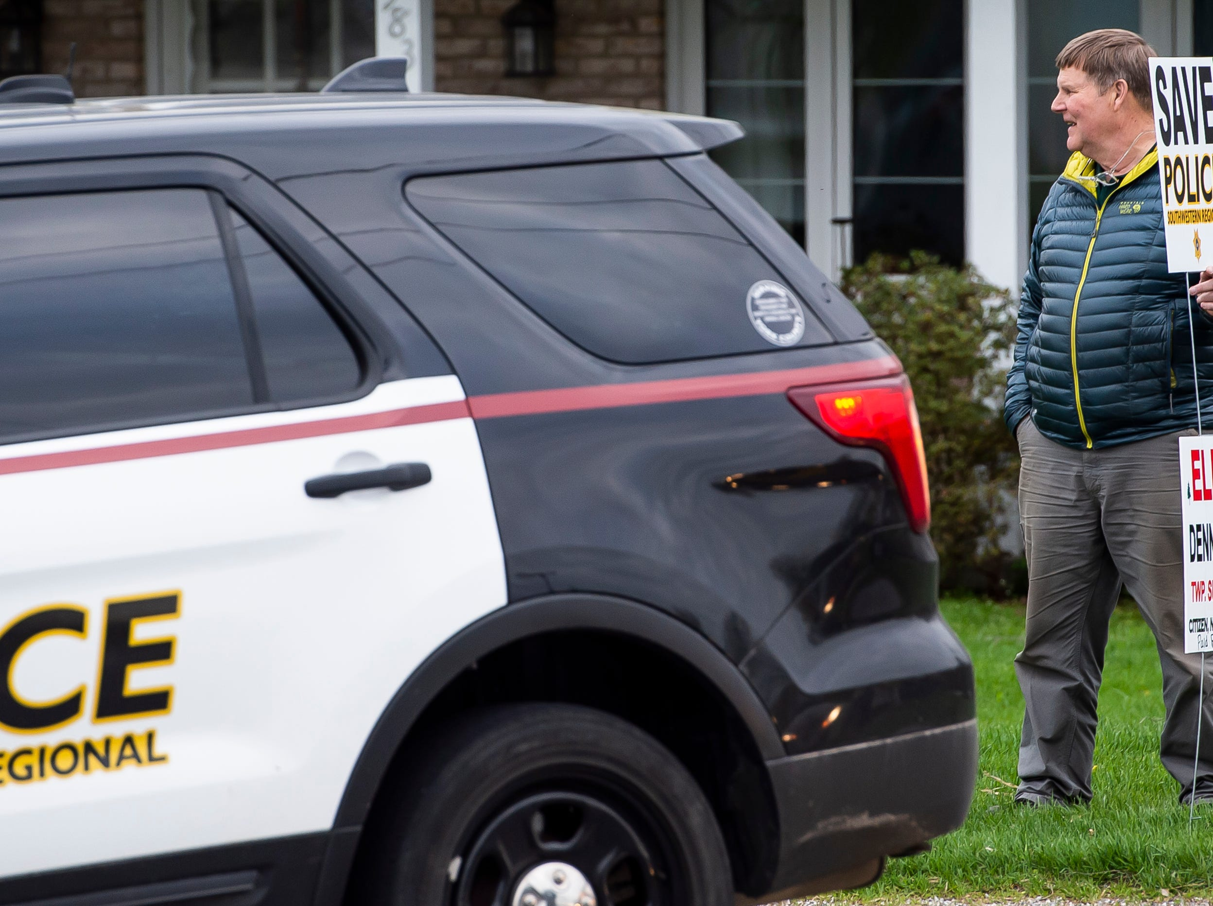 Bill Kaiser shows his support for Southwestern Regional Police as a Southwestern cruiser pulls into the North Codorus Township building parking lot on Tuesday, April 16, 2019.