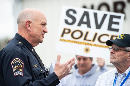 Southwestern Regional Police Chief Gregory Bean talks with people before the start of a North Codorus Township meeting on Tuesday, April 16, 2019.