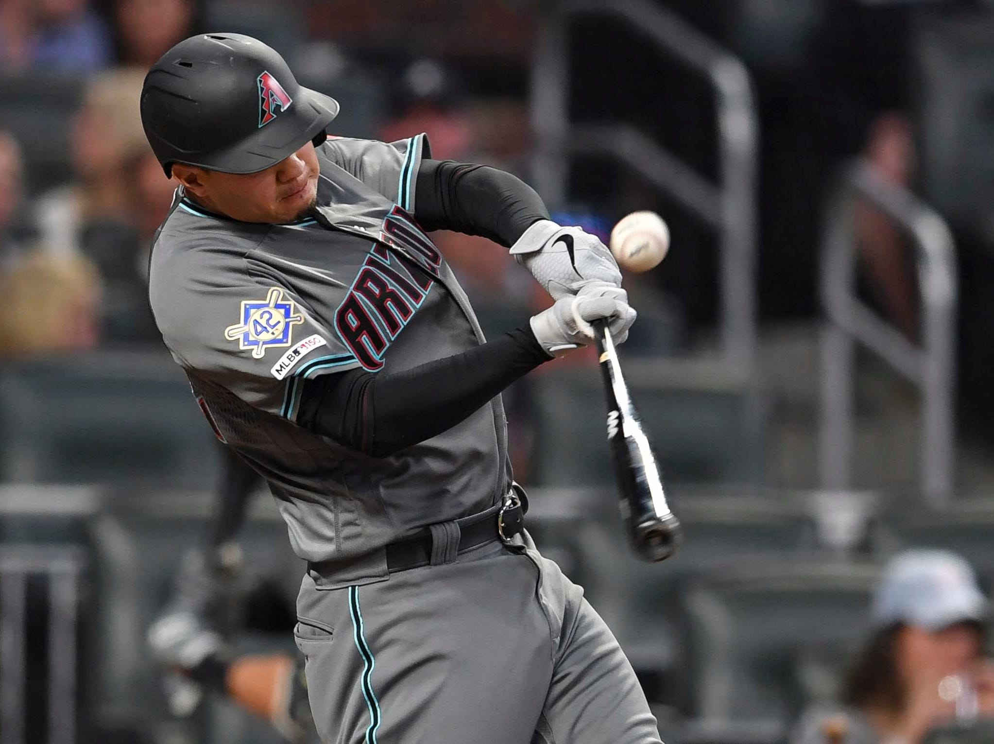 Apr 16, 2019; Atlanta, GA, USA; Arizona Diamondbacks second baseman Wilmer Flores (41) singles before scoring against the Atlanta Braves during the fourth inning at SunTrust Park. Mandatory Credit: Dale Zanine-USA TODAY Sports