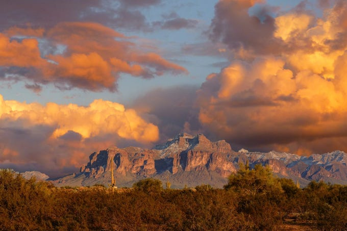 This photo was taken several years ago, but shows some impressive storm clouds over the Superstition Mountains in Mesa