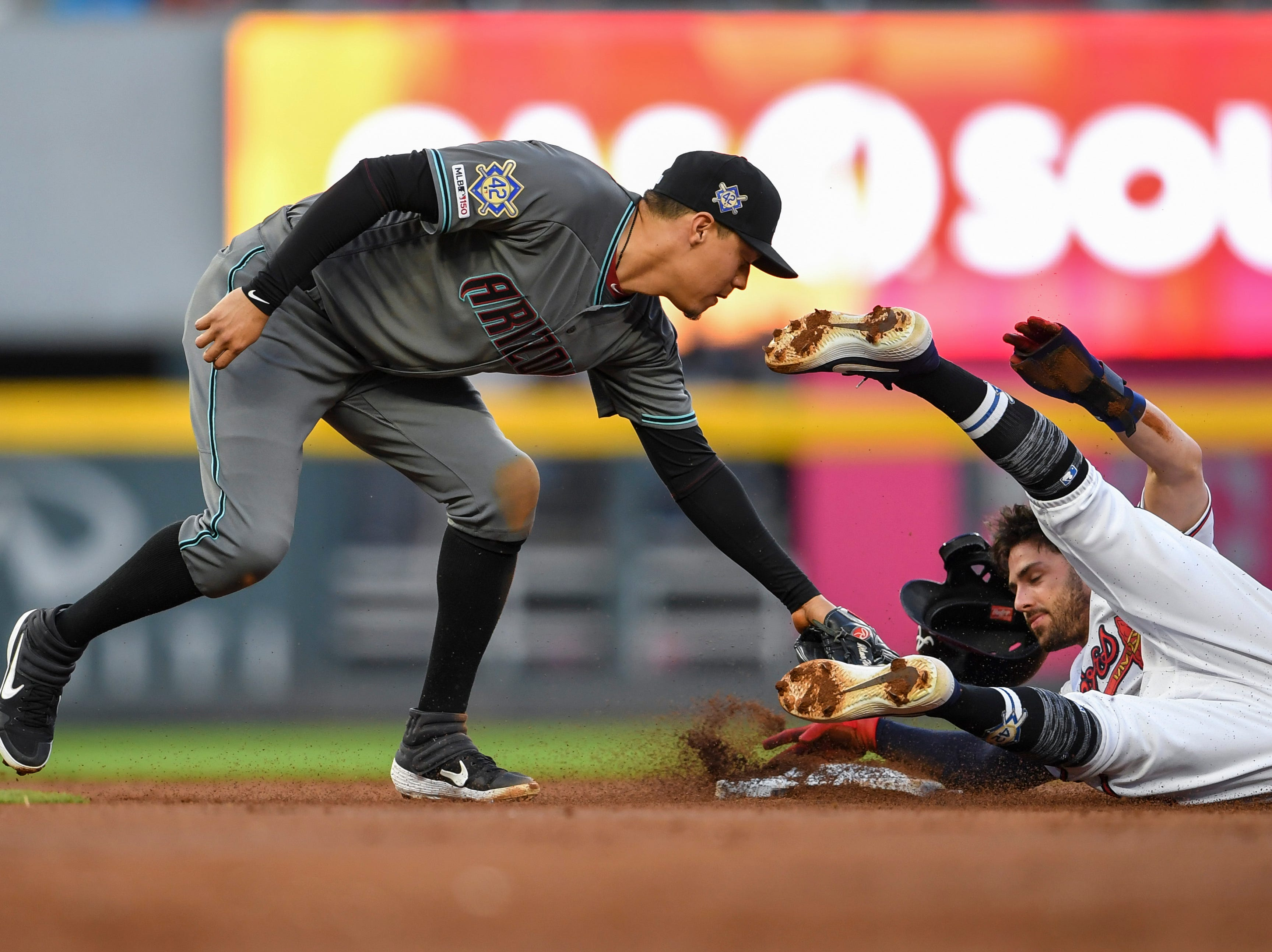 Apr 16, 2019; Atlanta, GA, USA; Arizona Diamondbacks second baseman Wilmer Flores (41) tags out Atlanta Braves shortstop Dansby Swanson (7) on a steal attempt during the second inning at SunTrust Park. Mandatory Credit: Dale Zanine-USA TODAY Sports