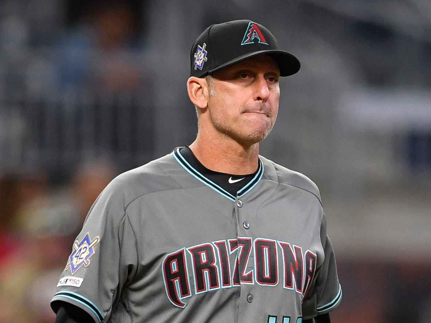 Apr 16, 2019; Atlanta, GA, USA; Arizona Diamondbacks manager Torey Lovullo (17) walks to the mound to change pitchers against the Atlanta Braves during the seventh inning at SunTrust Park. Mandatory Credit: Dale Zanine-USA TODAY Sports