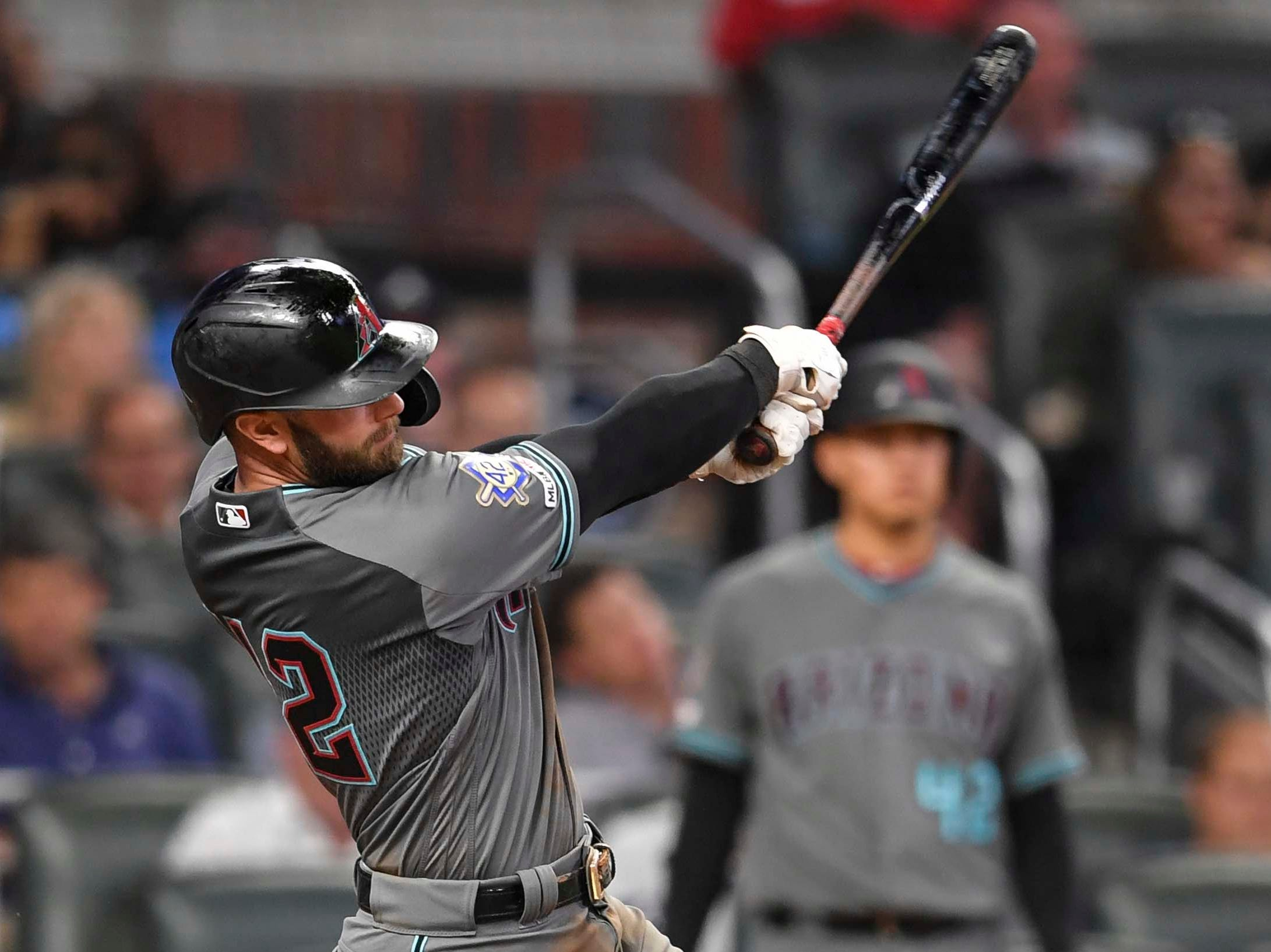 Apr 16, 2019; Atlanta, GA, USA; Arizona Diamondbacks tfirst baseman Christian Walker (53) singles driving in a run against the Atlanta Braves during the seventh inning at SunTrust Park. Mandatory Credit: Dale Zanine-USA TODAY Sports