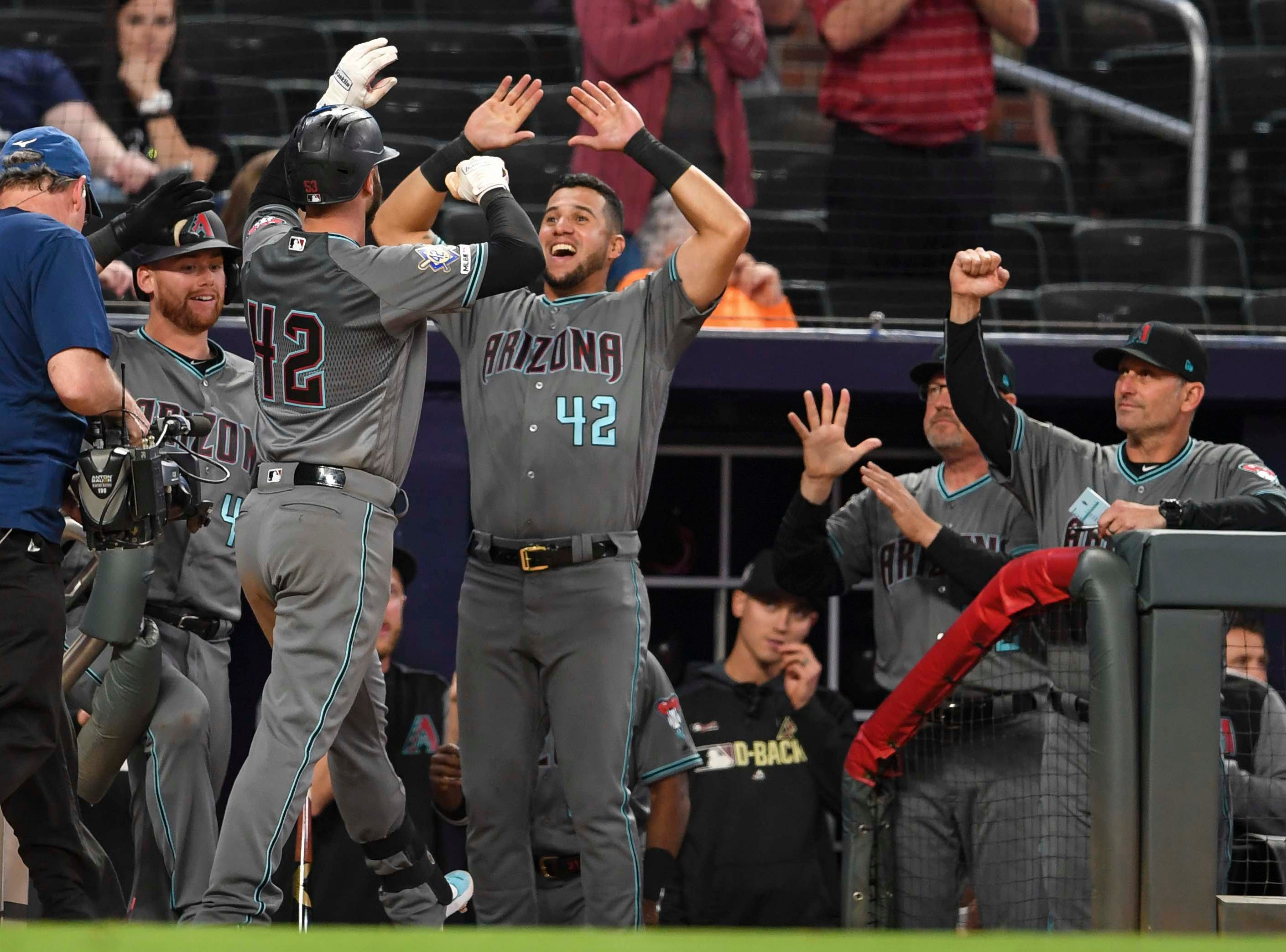 Apr 16, 2019; Atlanta, GA, USA; Arizona Diamondbacks first baseman Christian Walker (53) (white gloves) reacts with teammates in the dugout after hitting a home run against the Atlanta Braves during the ninth inning at SunTrust Park. Mandatory Credit: Dale Zanine-USA TODAY Sports