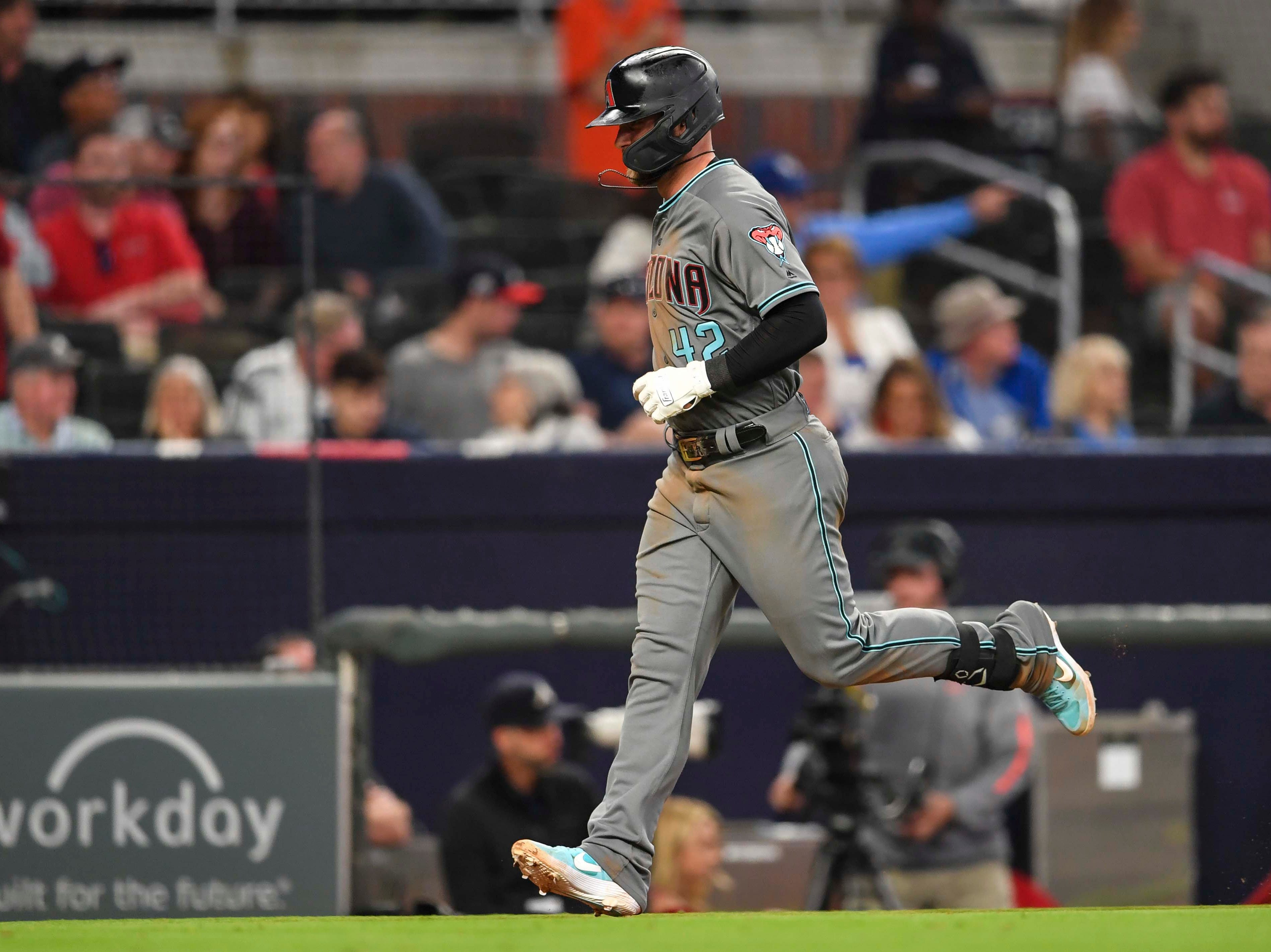 Apr 16, 2019; Atlanta, GA, USA; Arizona Diamondbacks first baseman Christian Walker (53) runs home after hitting a home run against the Atlanta Braves during the ninth inning at SunTrust Park. Mandatory Credit: Dale Zanine-USA TODAY Sports