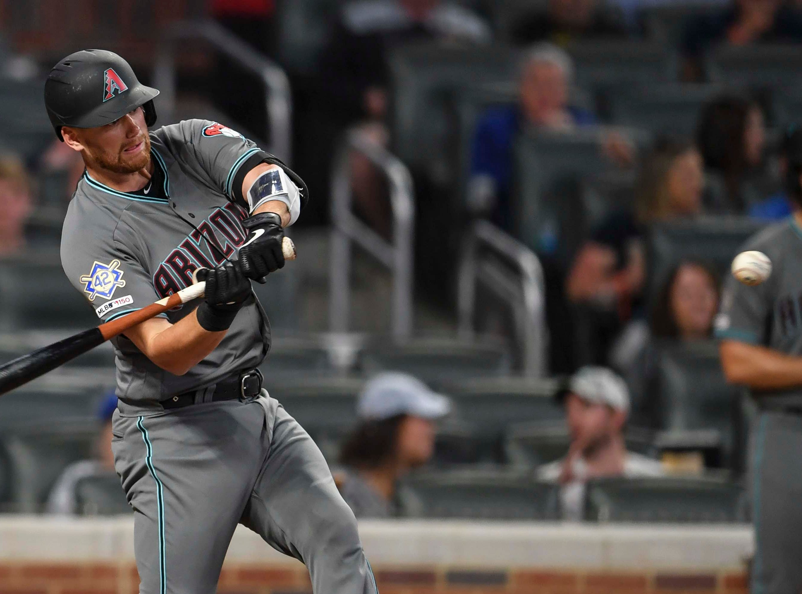 Apr 16, 2019; Atlanta, GA, USA; Arizona Diamondbacks catcher Carson Kelly (18) doubles driving in a run against the Atlanta Braves during the fourth inning at SunTrust Park. Mandatory Credit: Dale Zanine-USA TODAY Sports