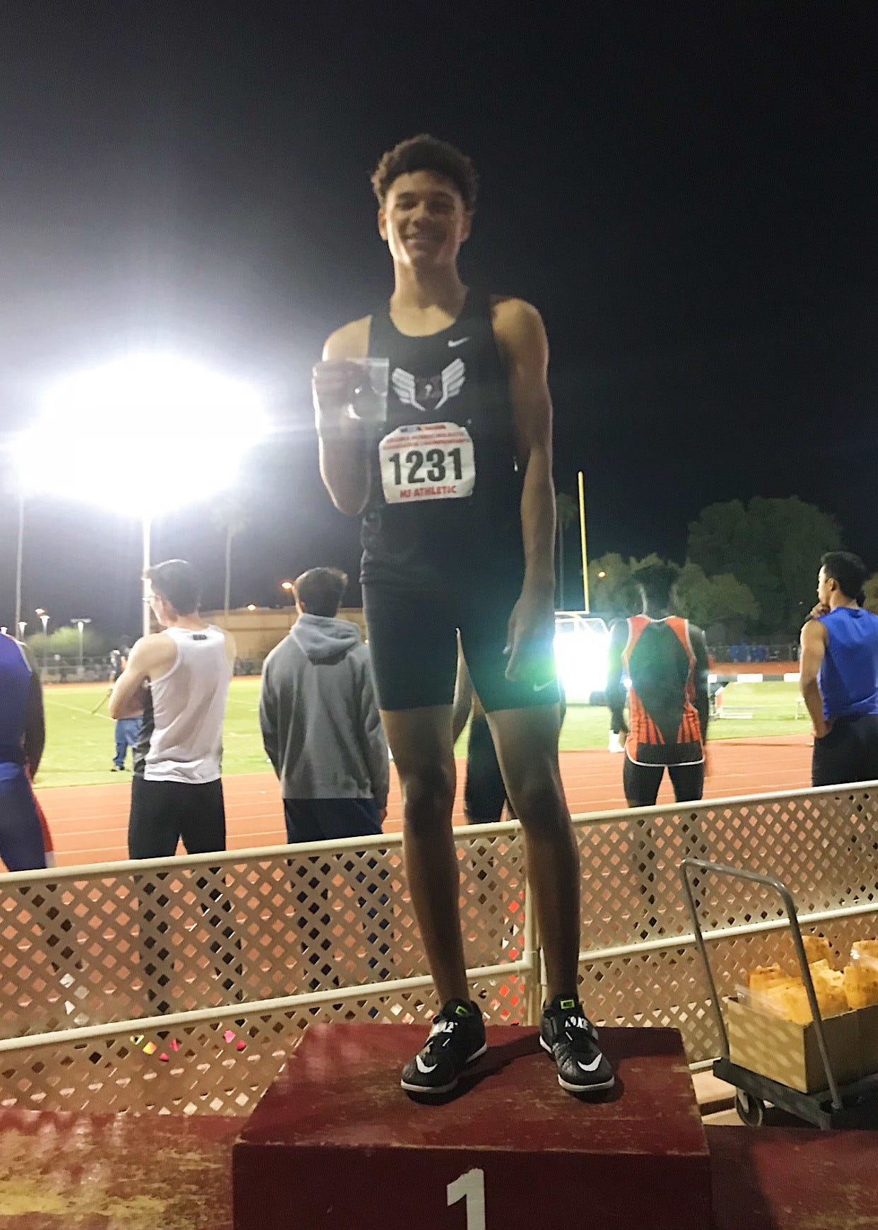Malik Whitaker wins first place in high jump event at Brophy Prep AMDG Invitational on March 23, 2019