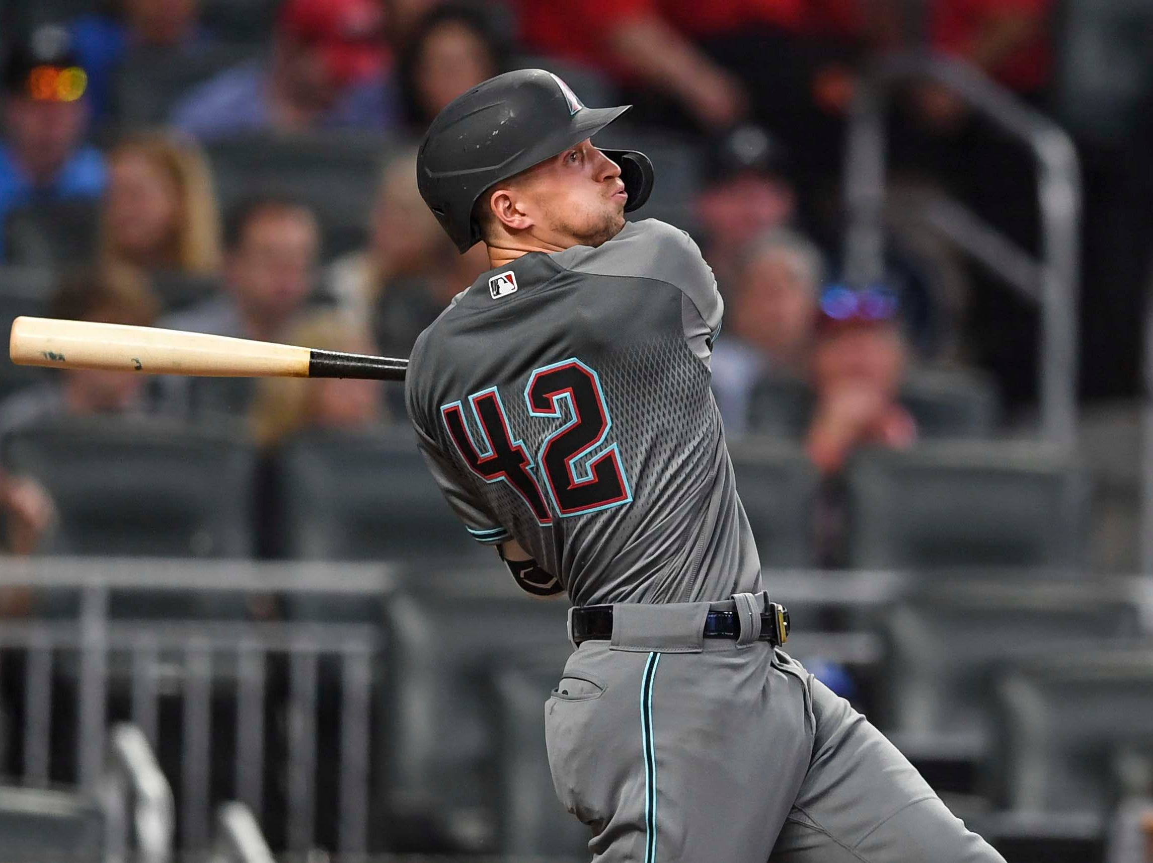Apr 16, 2019; Atlanta, GA, USA; Arizona Diamondbacks shortstop Nick Ahmed (13) singles to drive in a run against the Atlanta Braves during the fourth inning at SunTrust Park. Mandatory Credit: Dale Zanine-USA TODAY Sports