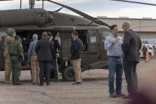 Arizona Gov. Doug Ducey (second from right) recently toured sections of the border fence in Nogales, Arizona, with Vice President Mike Pence and Border Patrol agents.